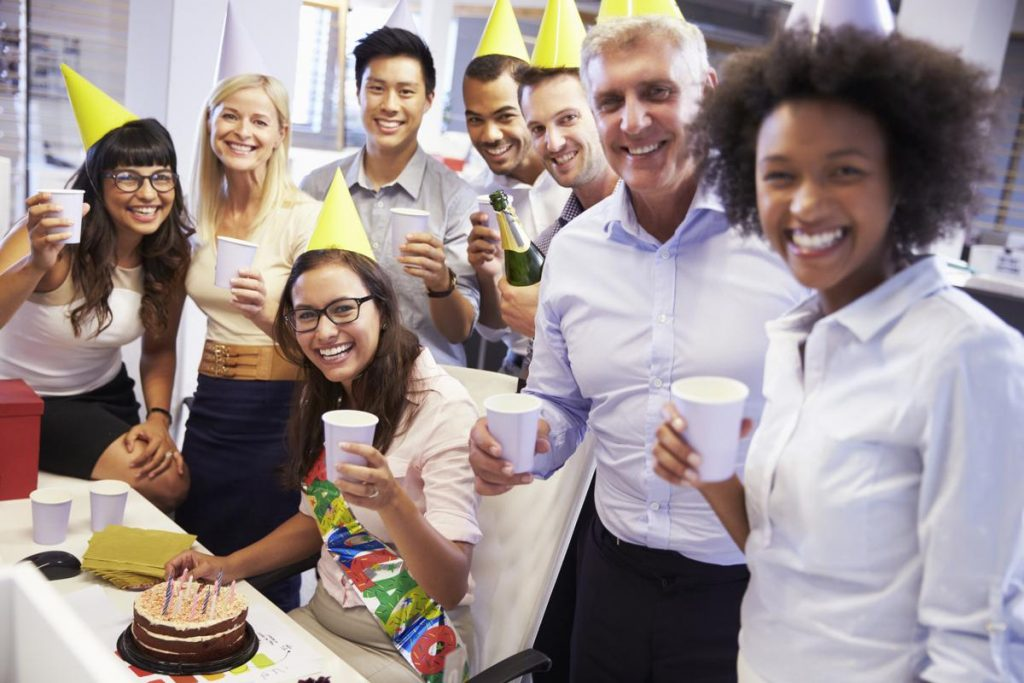 Happy office workers at their party